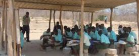 Students taking lessons in a makeshift classroom
